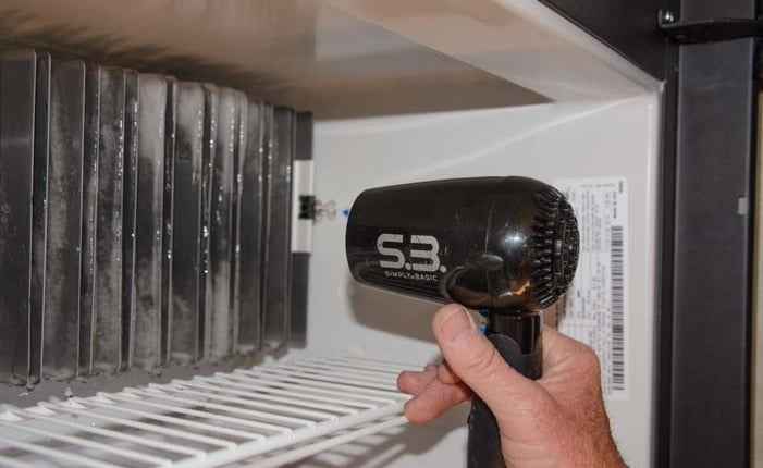 defrosting with a hairdryer